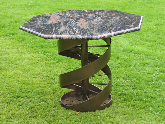 Helix table: powder coated black bronze with granite top, PMF Designs